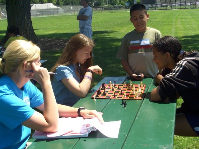 Kids Playing Chess at the Park